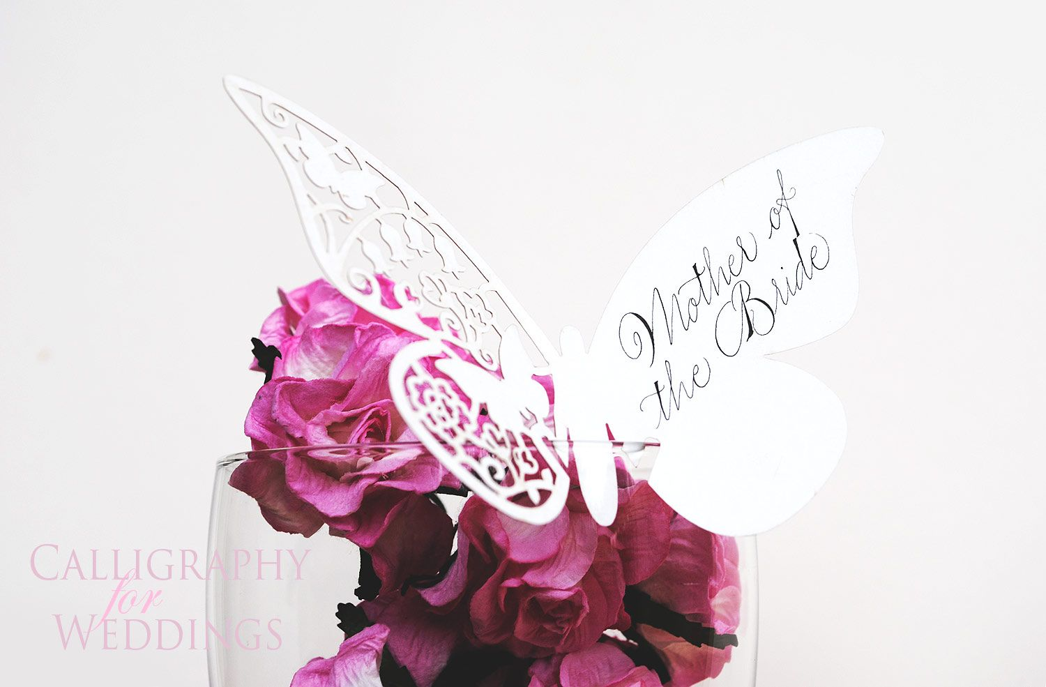 Calligraphy butterfly wedding place name - by Calligraphy-for-Weddings.com