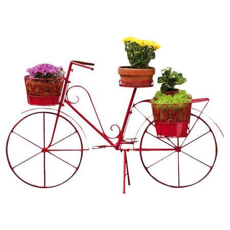 "Red metal bicycle planter with scrollwork detail. Holds four pots.  Product: PlanterConstruction Material: MetalColor: RedFeatures: Space for four pots of flowersDimensions: 54.25"" H x 33"" W x 17"" D"