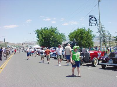 COURTESY/Tourism Development CommissionSpectators check out classic and antique cars from the Great Race that came through Kingman in 2007.