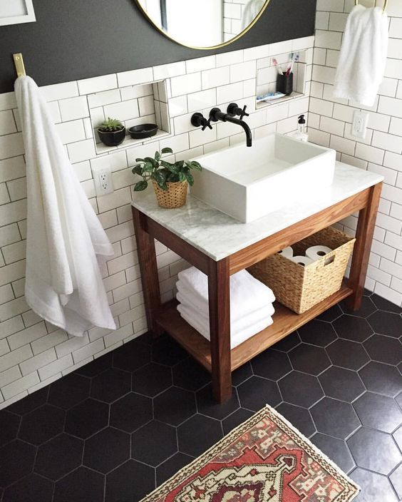 white tiles on the walls and black hexagon tiles on the floor for