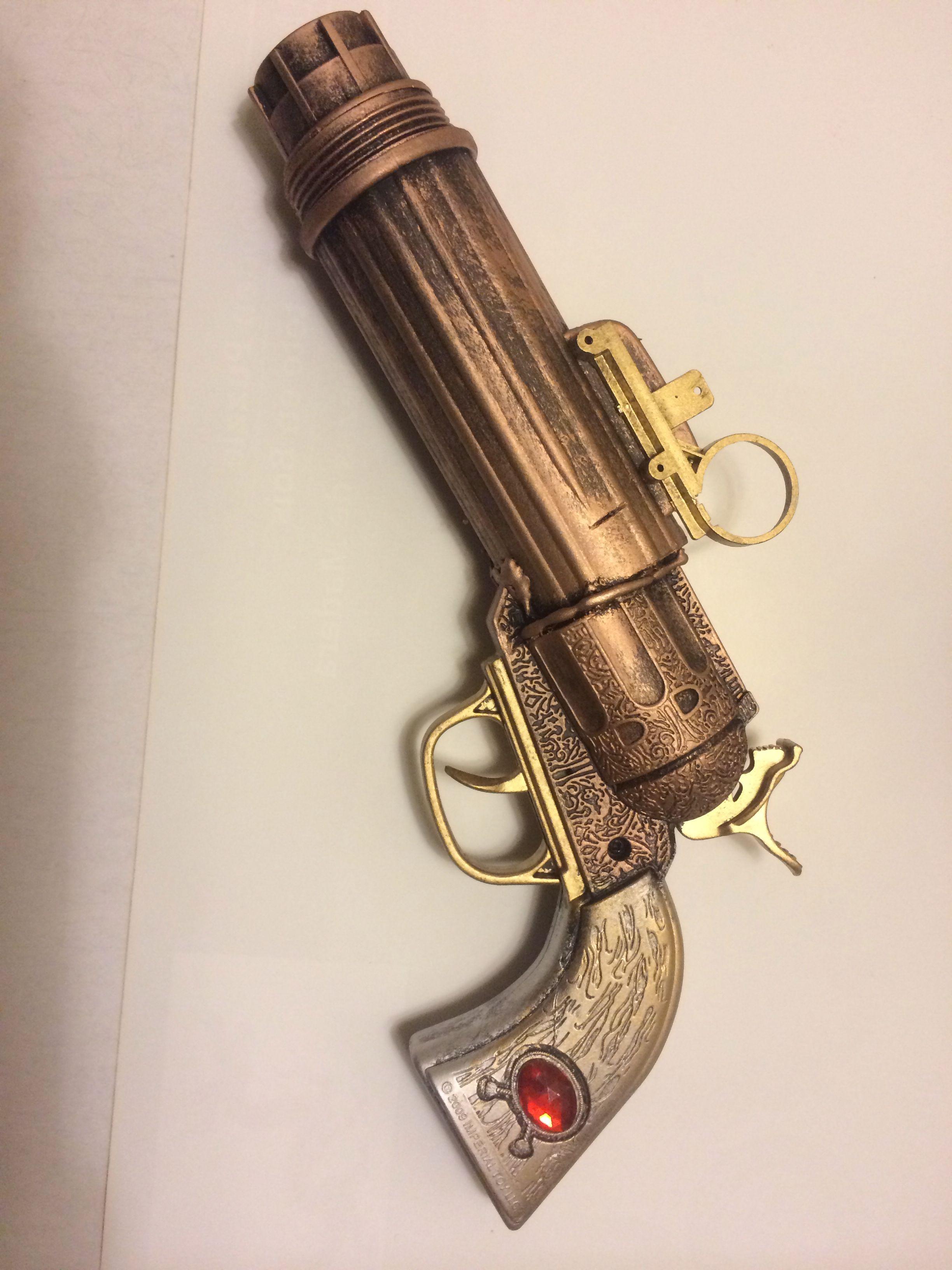 Plastic cap gun steampunk'd  Random flashlight parts and toy truck