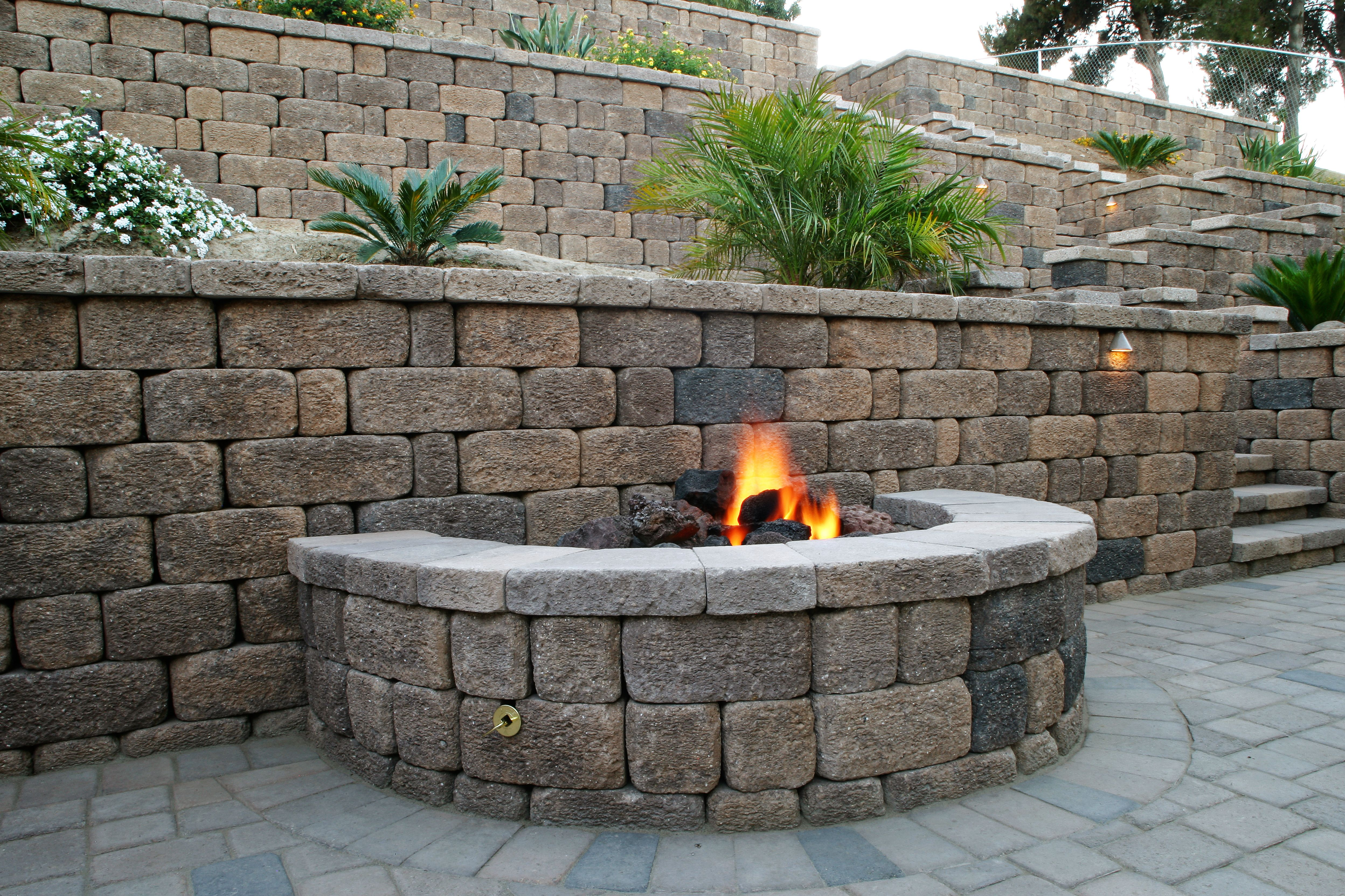 Cool keystone country manor fire pit built into a country for Built in fire pits designs