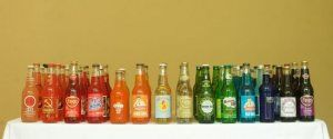 soda bottles in rainbow order