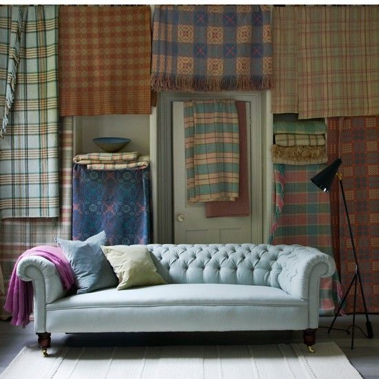 Plaid Living Room With Chesterfield Sofa