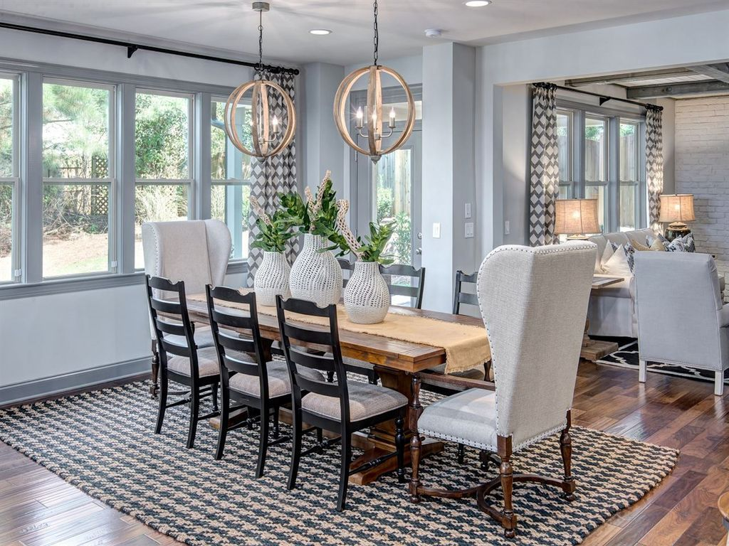 I love the light fixtures and the two end chairs dining rooms
