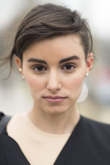 Your Top Pins of the Week: Parisian Street Style and Chanel Polish: This windswept style with bold brows was your favorite among all the Parisian street-style looks. This fashionista just has that je ne sais quoi.
