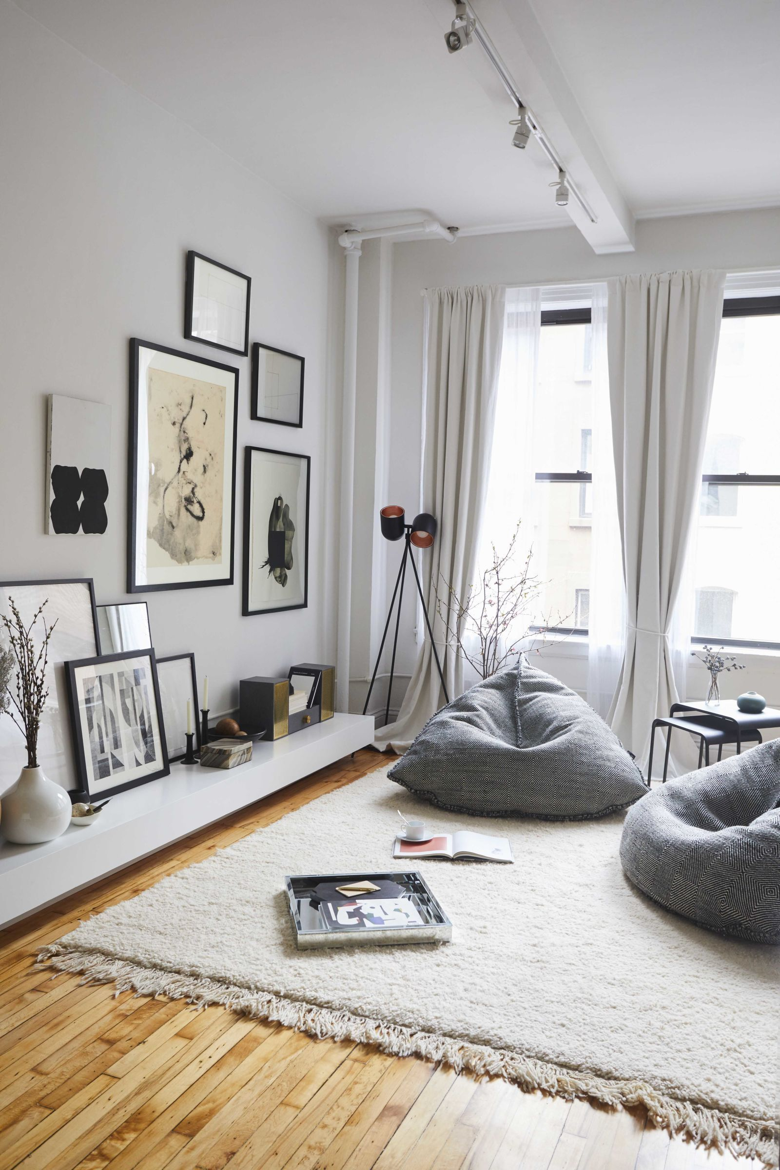 living room bean bags quotes this couple s insanely chic apartment is also their storefront for bag chairs relax