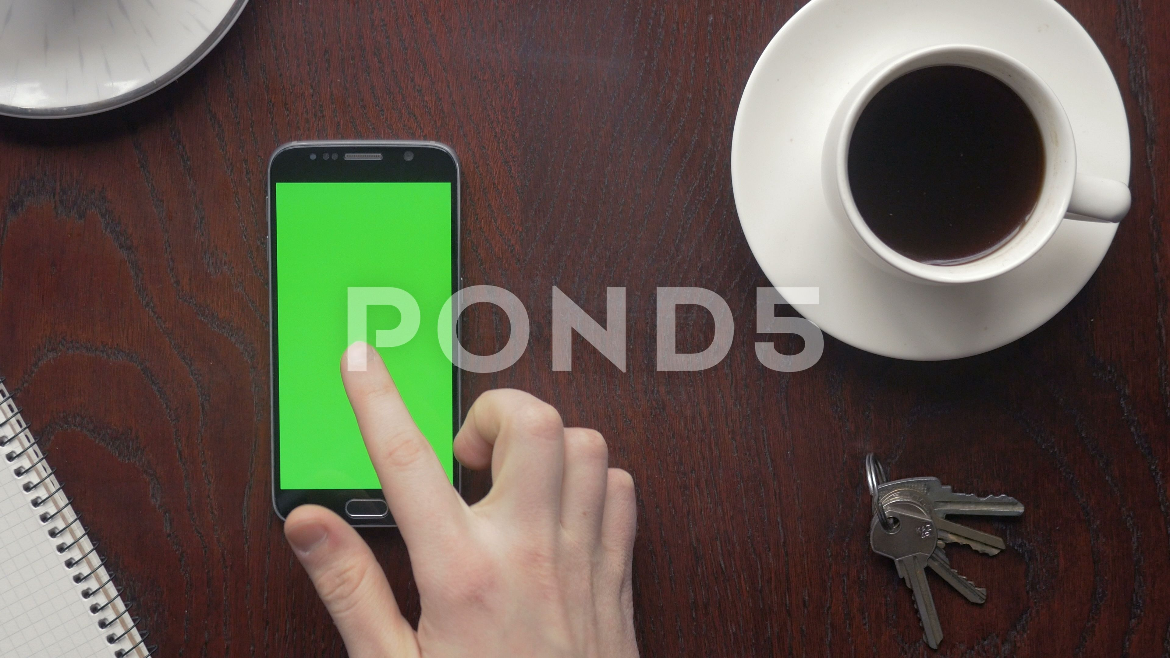 Man Making Various Gestures On The Green Screen Of A Phone Stock Footage Ad Gestures Green Man Making Greenscreen Wooden Tables Coffee Cups