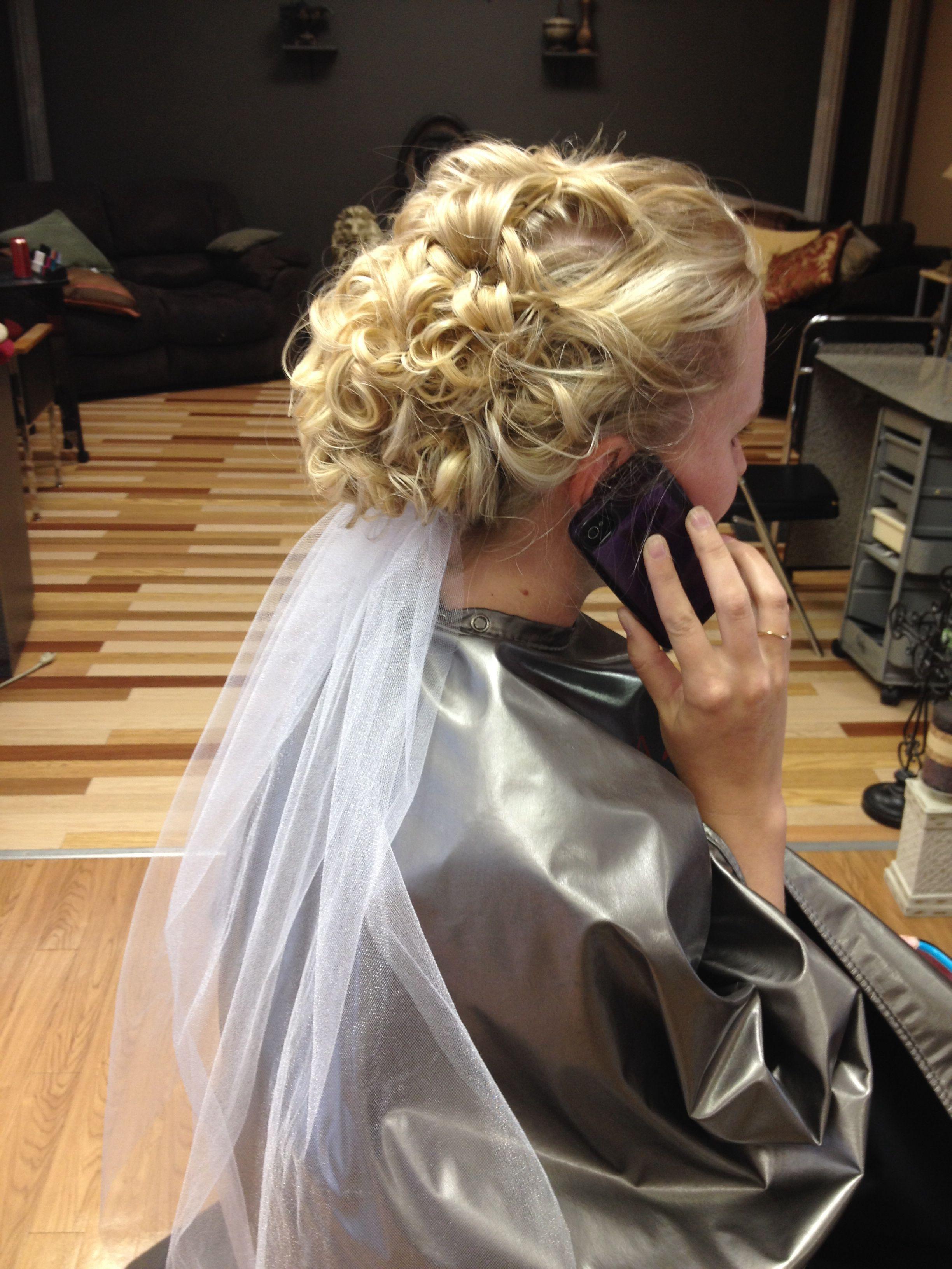 curly wedding updo with veil underneath. #weddinghairflowers