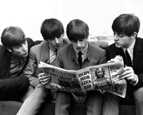 The Beatles reading The Daily Prophet.