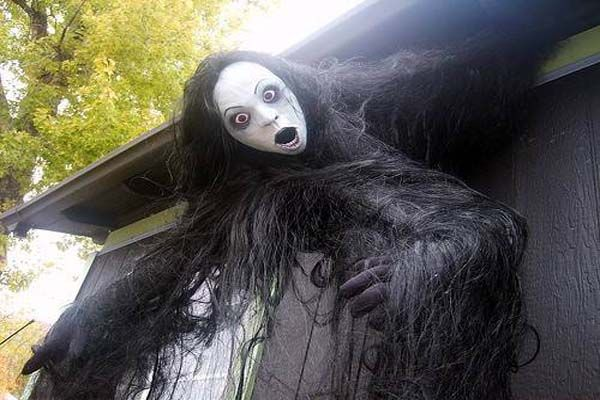 Decoration Very Creepy Outside Halloween Decorating Ideas With Sinister Figure Haired Woman Emerged From The