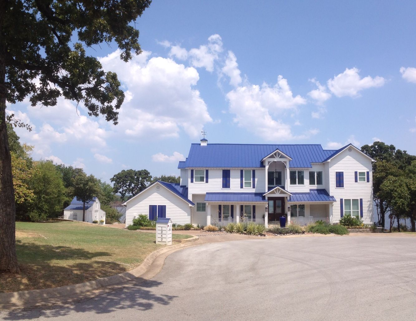 Dream White House Blue Shutters And Blue Tin Roof House Paint Exterior Tin Roof House Shutters Exterior