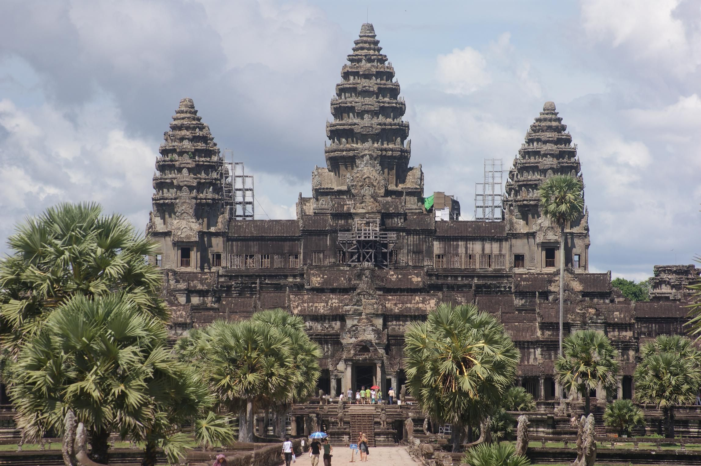 Angkor Wat (Khmer: អង្គរវត្ត) was first a Hindu, then subsequently, a Buddhist temple complex in Cambodia and the largest religious monument in the world. The temple was built by the Khmer King Suryavarman II in the early 12th century in Yasodharapura (Khmer: យសោធរបុរៈ, present-day Angkor), the capital of the Khmer Empire, as his state temple and eventual mausoleum.