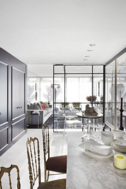 The glass wall outlining the dining room complements the simple dining room, with small intricate detailing on the chairs for a subtle nod towards the French style. (designshuffle blog)