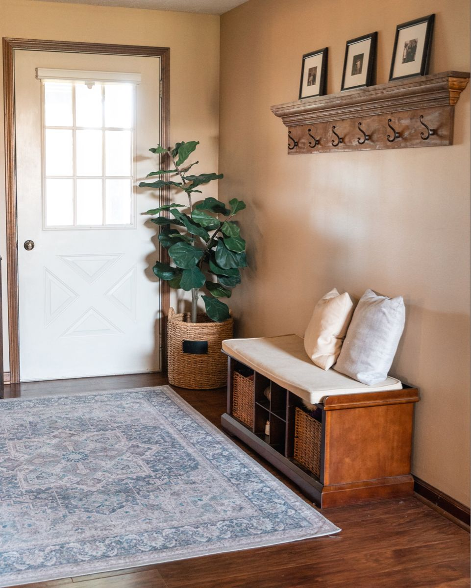 Add lots of functionality to an entry way with a storage bench and baskets. A washable waterproof rug is a must for families with kids and pets. #homedesignideas #entrywaydecorating #entrywayideas #entrywaydecorideas #entryway #ruggable #targethomedecor #targetstyle