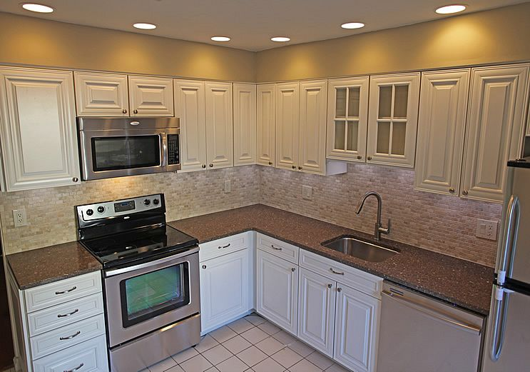 Remodel Kitchen With White Cabinets that's what white/cream cabinets would look like with the brick