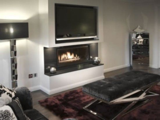 Fireplace Wall Designs family room tv and fireplace wall with hidden storage family room Fireplace Tv Wall Design 8
