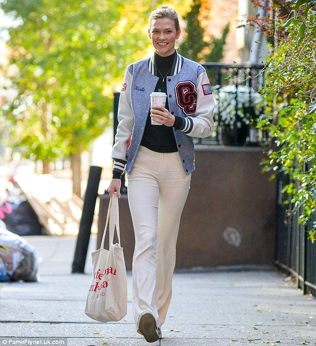 Fashion first:An on-trend roll neck sweater and cream slacks completed a rather subdued ensemble, while shimmering silver pumps gave it a distinctive flourish