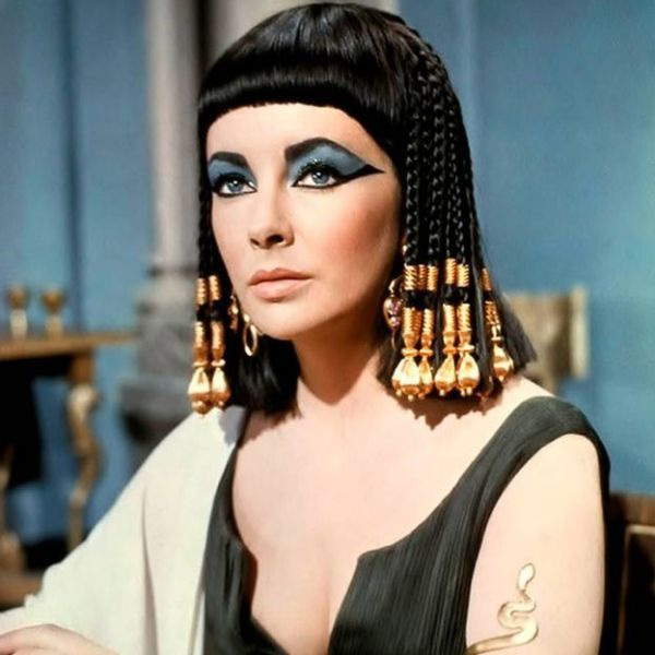 Elizabeth Taylor As Cleopatra - Your Cleopatra costume checklist: blue eye shadow, black liquid eyeliner, clip-on bangs (if you don't have them already) and gold accessories, lots of gold accessories.