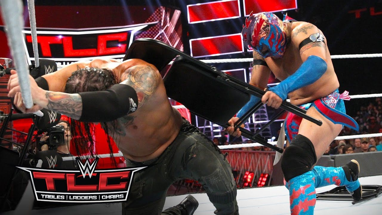 steel chair in wrestling folding stand kalisto relies on chairs to cut baron corbin down size wwe tlc