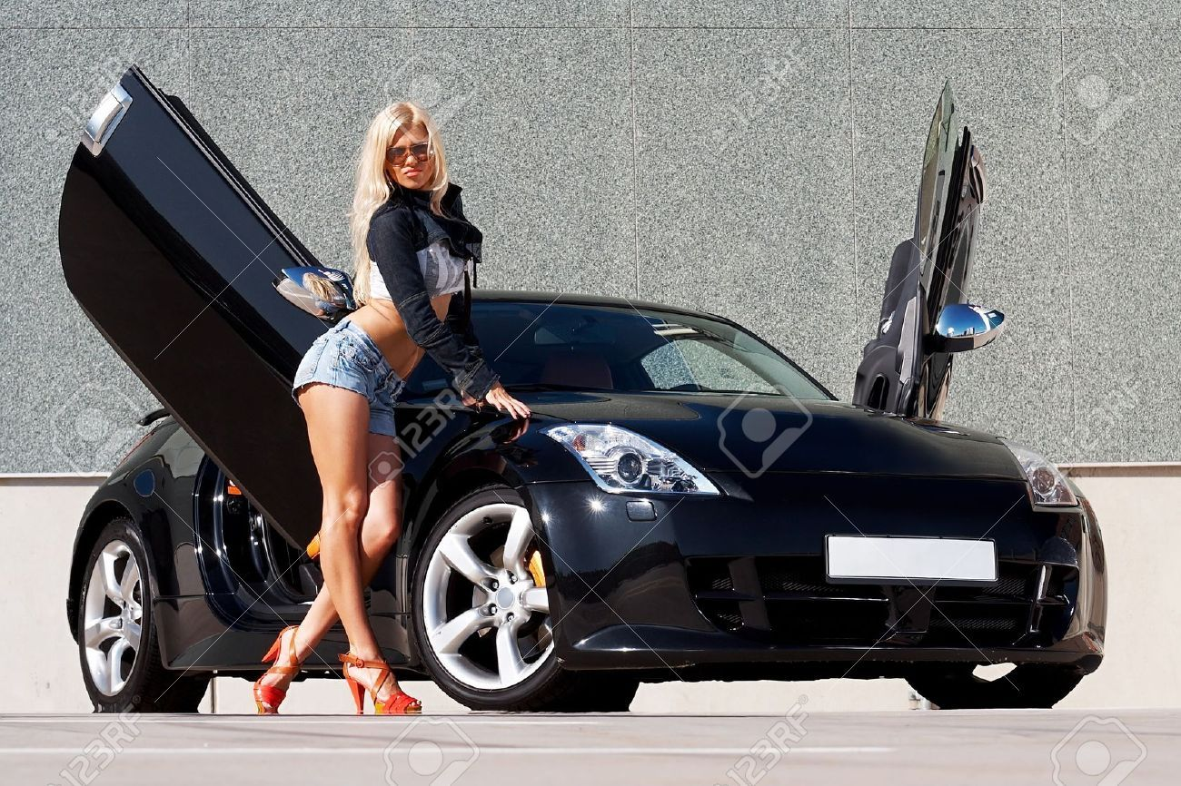 Sexy Babe Standing In Front Of Tuned Supercar Stock Photo Picture