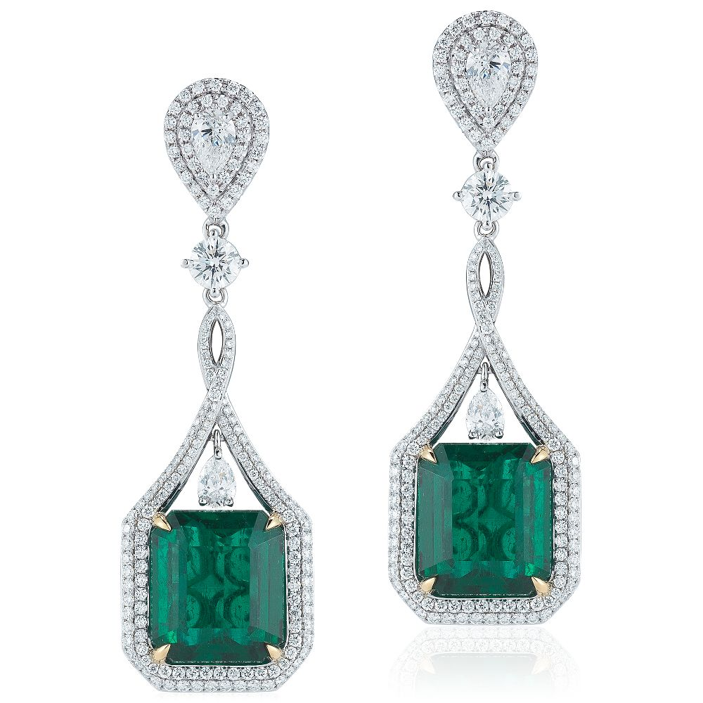 Emerald and Diamond Drop Earrings in 18k White Gold (24.05 ct. tw.) from Blue Nile.  Graceful and sophisticated, these one-of-a-kind dramatic drop earrings feature over 24 carats total weight of stunning, vibrant emeralds and diamonds pav set in 18k white gold, ideal for special occasions. Emeralds are accompanied by GIA grading reports.
