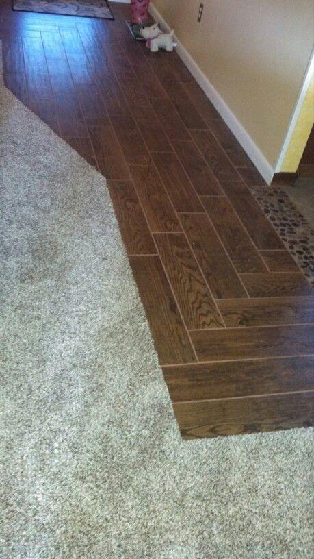 My new carpet by new tile in livingroom