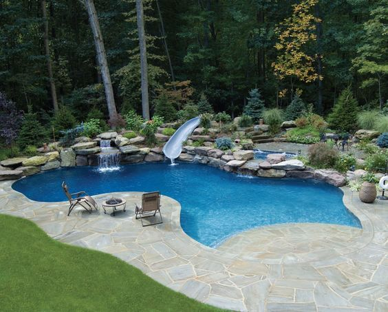 beach entry gunite pool with dolphin water slide - Gunite Pool Design Ideas