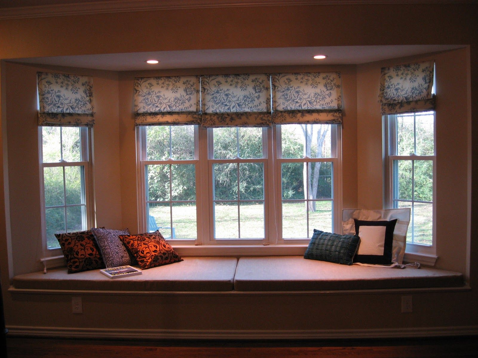 Bay Window Decorations With Conservative White Wooden Frames Folding Floral Curtain Design For