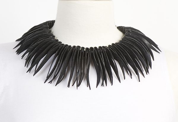 Rubber Dress with White Feathers