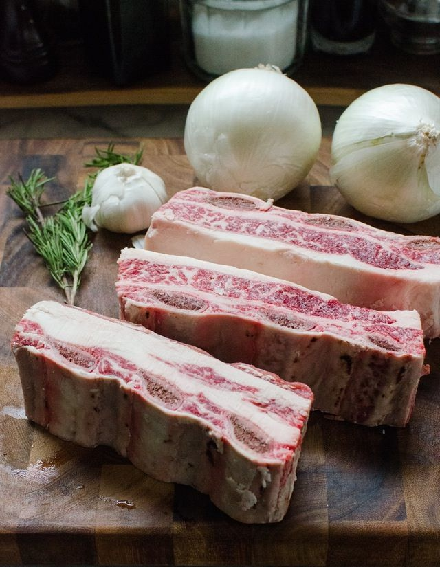 Short ribs are the quintessential caveman cut, straight out of Fred Flinstone's larder, with their hunks of rich meat on the bone, looking primal and carnivore-ready. They're a rich winter meal, too, easy and forgiving to cook under their sleek caps of fat, melting into tender chunks of pull-apart beef in the oven. If you're feeling like a hibernating caveman and want a delicious, comforting, beefy meal, here's a step-by-step recipe to help you take short ribs and turn them into a dinner…