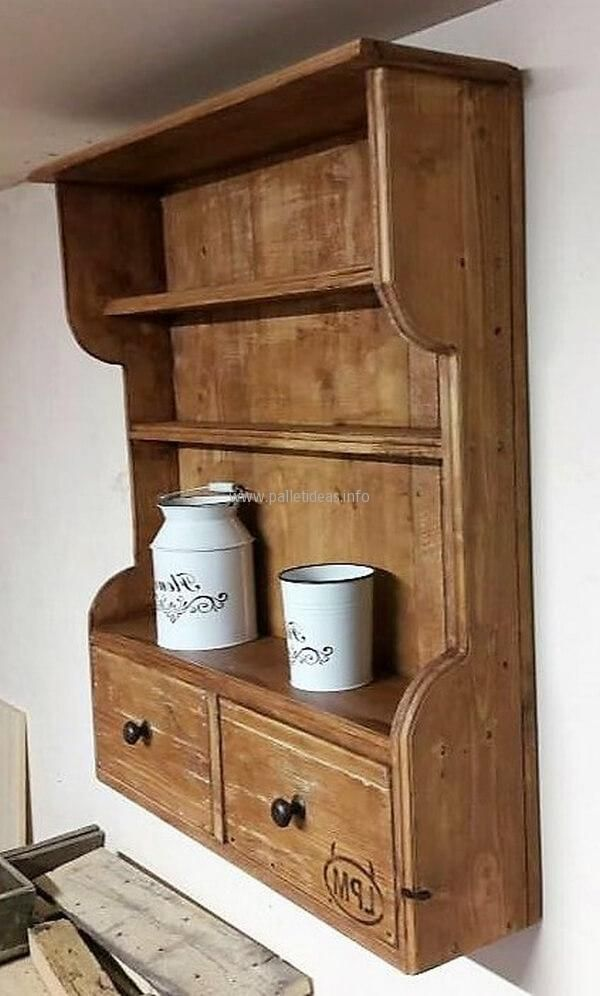 The space above the repurposed wood pallet shelf for the kitchen can also be utilized for storing the items which are not used often and are only unpacked from the box when they are needed to serve the guests. The upper most layer of the shelf is perfect to place the mugs and glasses.