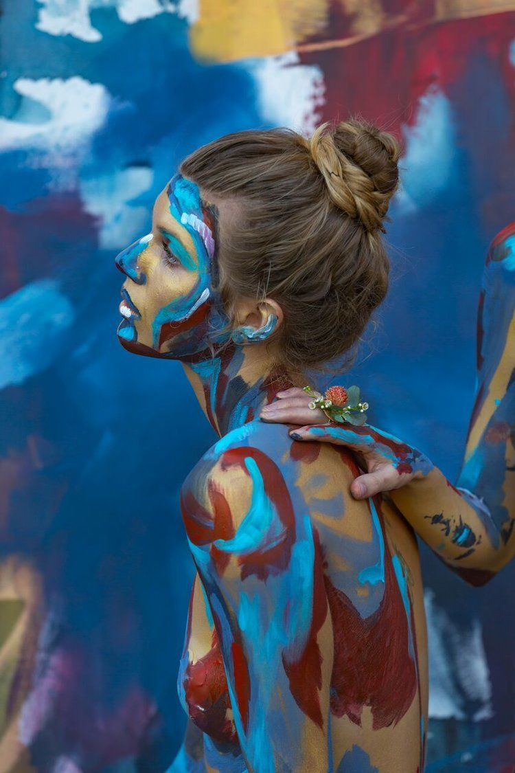 Live body painting event focusing on the human condition