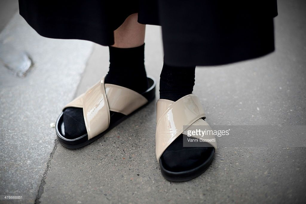 Stylist Maiko Shibata wears Tibi trousers and Celine sandals before Jean-Charles de Castelbajac show on March 4, 2014 in Paris, France.