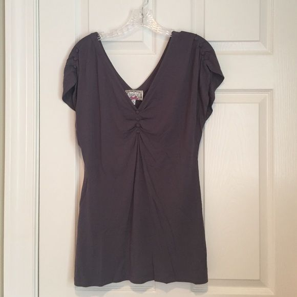Comfy and cute jersey top Jersey top with V-neckline in front and back and button details on the front and both shoulders. It hits below the hip. It would be super cute worn as a tunic over skinny jeans. The label is Baraschi from Anthro. The color is a purple/gray. There is some pulling at the bottom around the side seams. It's otherwise in good condition. Anthropologie Tops Tees - Short Sleeve