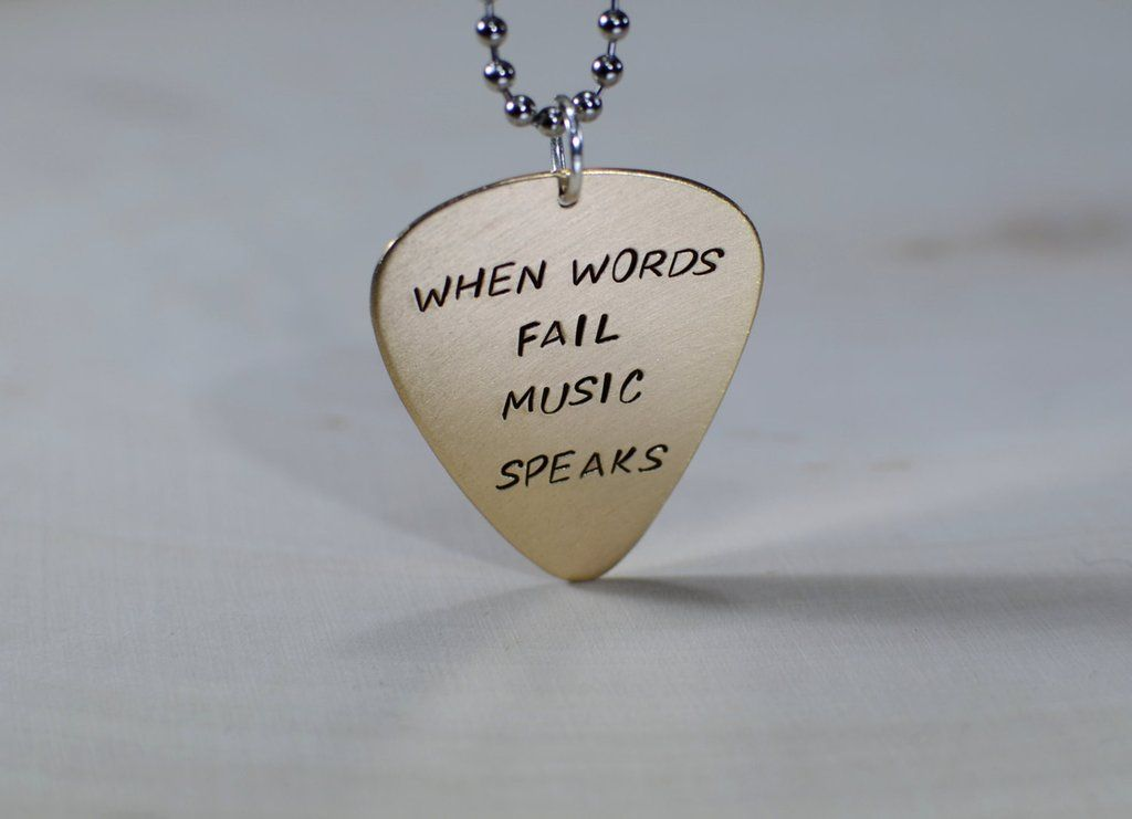 When words fail music speaks 14k yellow gold guitar pick pendant when words fail music speaks 14k yellow gold guitar pick pendant mozeypictures Choice Image