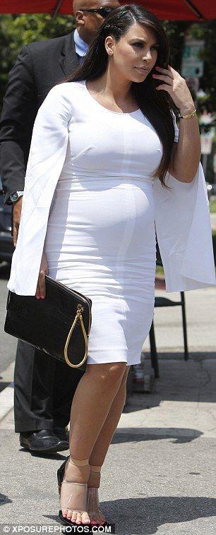 3d59794e935 Kim s got sole! Pregnant Kardashian reality star hangs up tight ...