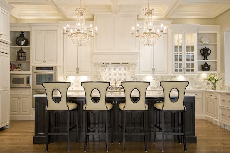 Stunning Kitchen With Coffered Ceiling Adorned A Pair Of Silver Leafed Crystal Chandeliers Over An