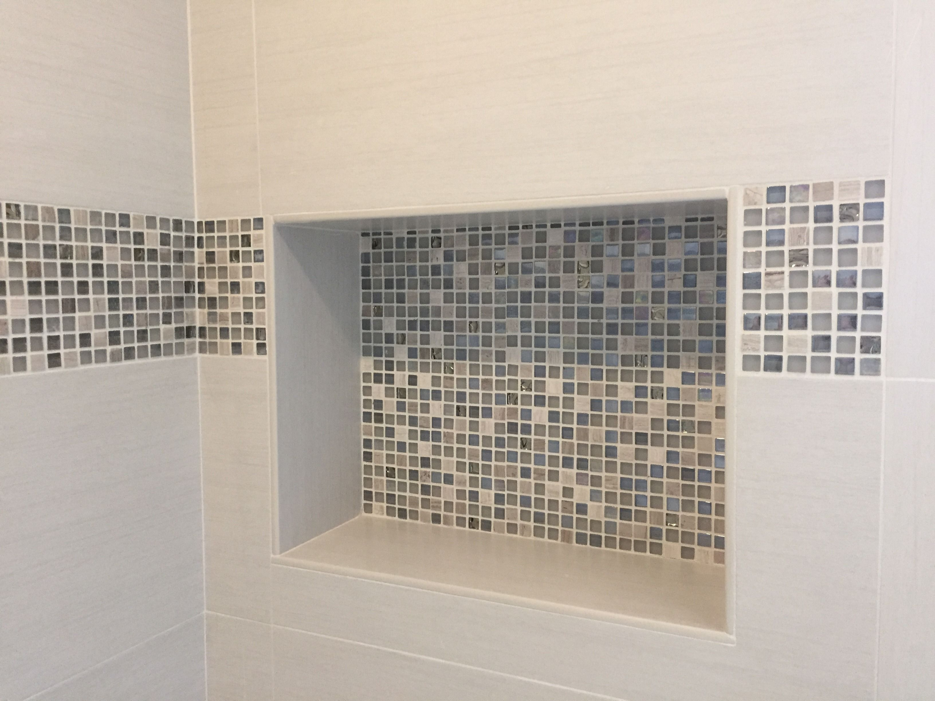 Need a solution for shower storage? Are you sick of those ugly hard-to-clean metal over-the-shower head shampoo holders! Go from bleh to bling with these great shower niche ideas! #showerniche #nichos https://arizonatile.com/en/products/browse?type=mosaics#utm_sguid=152185,49d3ede0-4a8f-c1ac-e606-6fdc1499001f