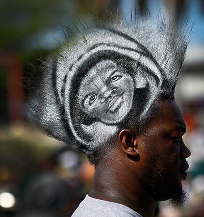 Miami, Florida, US: Mohawk Gaz wears a picture of Trayvon Martin in his hair as he and other supporters gather for a rally in his honour at the Bayfront Amphitheatre Photograph: Joe Raedle/Getty Images