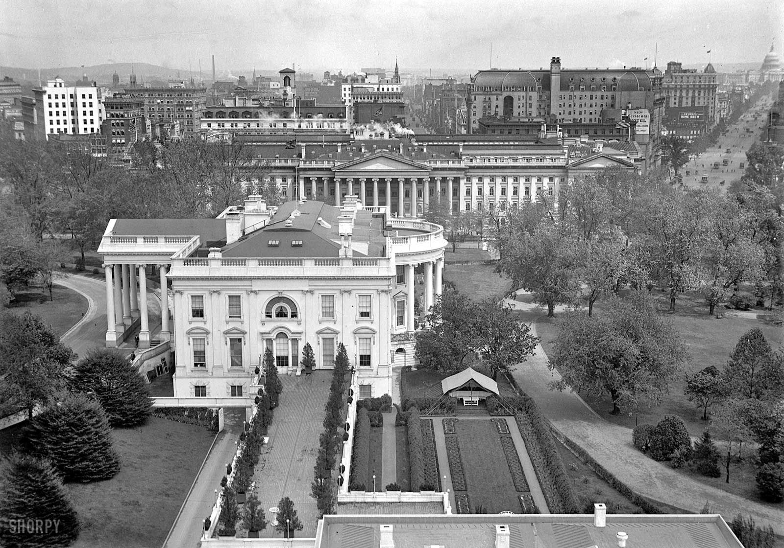 A 1914 view of the executive mansion (with tent in Rose Garden) from over the West Wing looking east past the Treasury building and along Pennsylvania Avenue to the Capitol