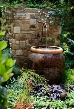 Ornate Tap With Glazed Olive Jar Making A Lovely Water Feature