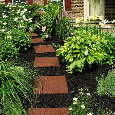 Garden Path Cement Pavers Spaced In Dirt Along Curved