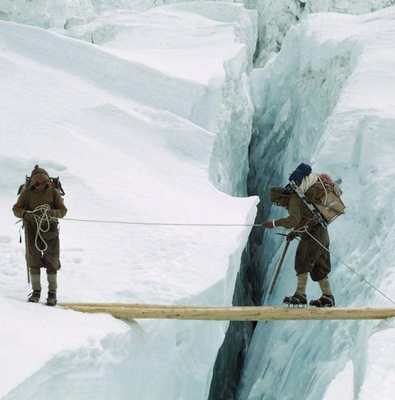 1953 - Sherpas in crampons cross a log bridge over a crevasse Western Cwm, Everest. © RGS-IBG/Alfred Gregory