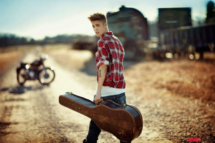Justin Bieber Guitar On His Hand Hd Wallpapers Free Wallpapers