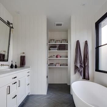 white shiplap bathroom with gray slate herringbone floor