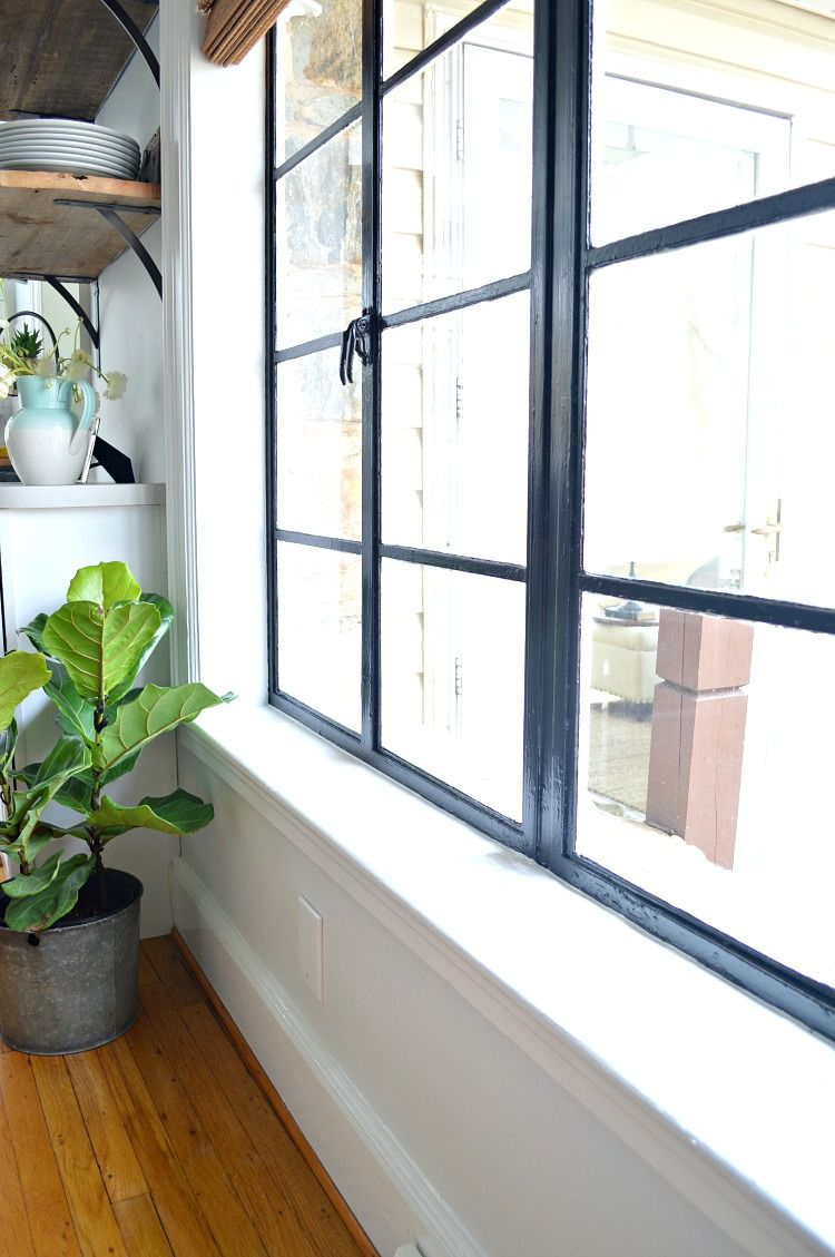Change Up The Look In Any Room Of Your House With Painted Black Window Frames An Easy And Inexpensive Diy Black Window Frames Black Window Trims Black Windows