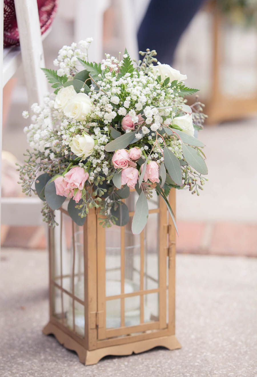 White ivory and light pink centerpiece flowers in gold