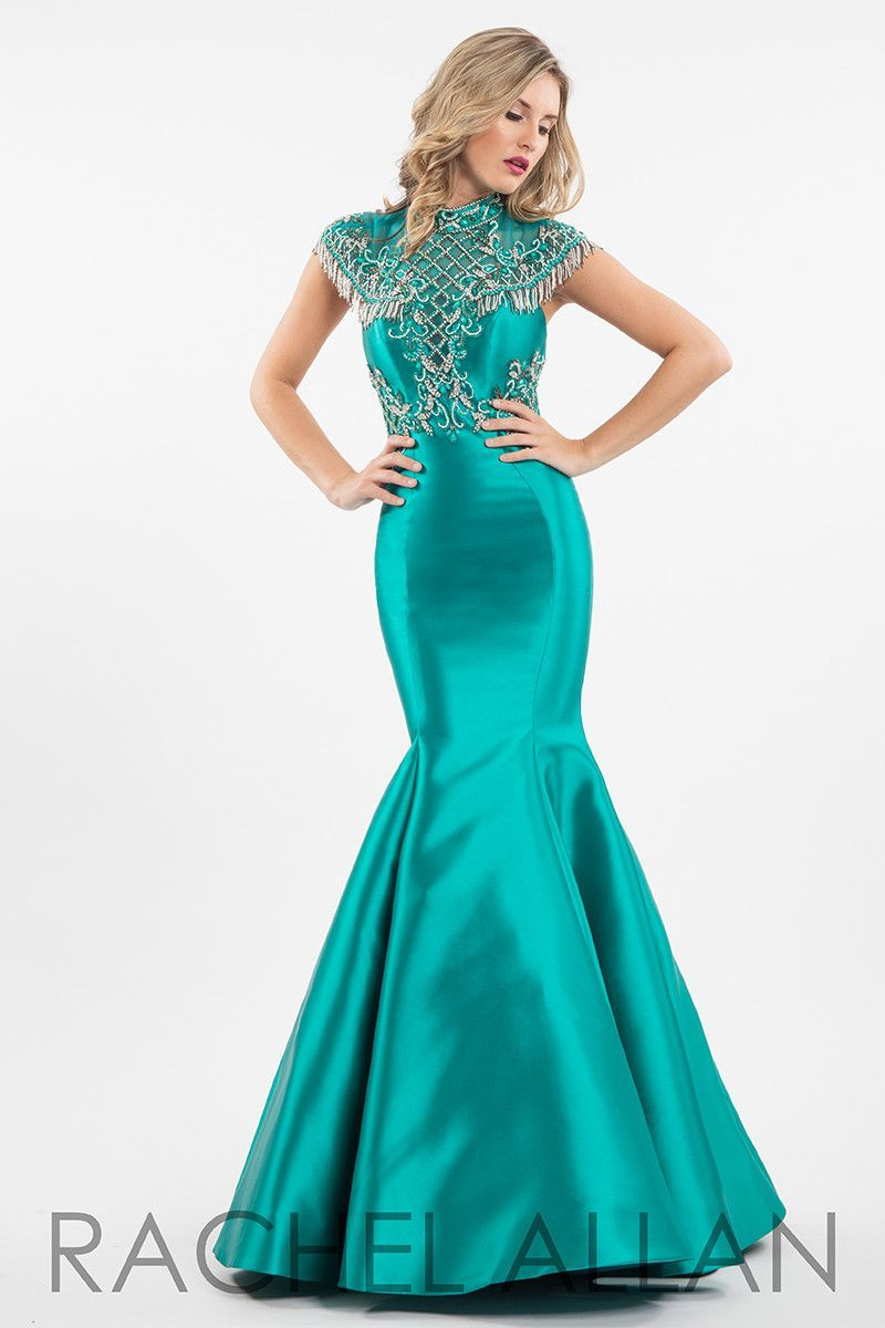 Be couture in this sleek mermaid with its high neck and cap sleeves