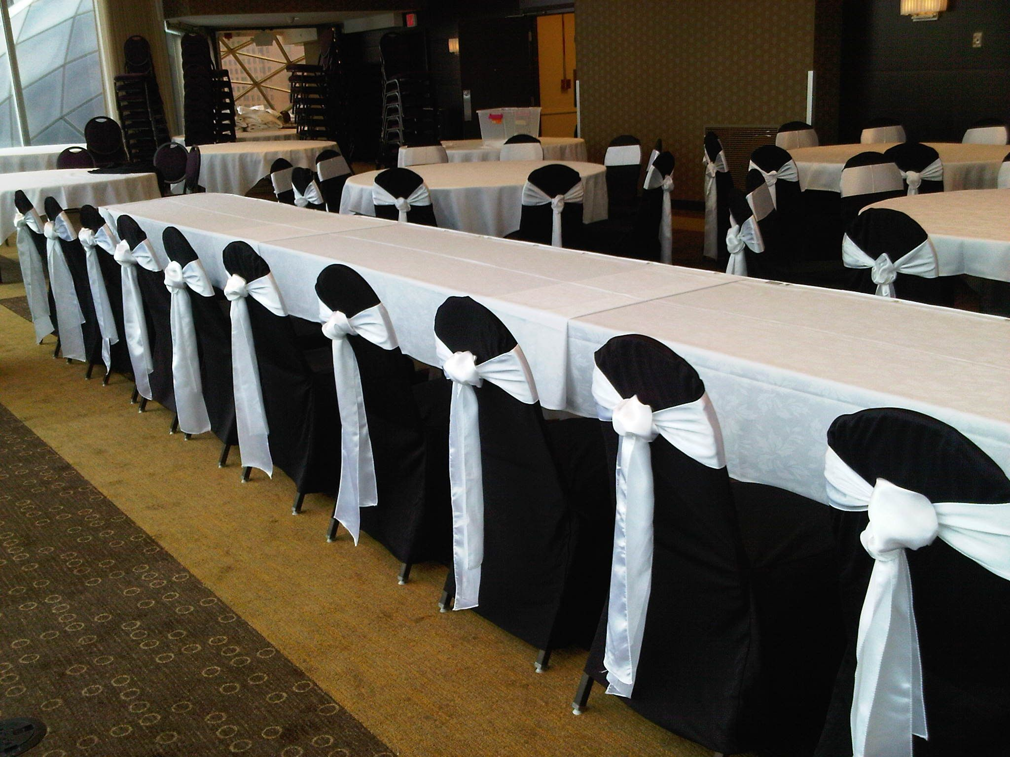Ivory Chair Covers with Navy Satin Sashes flip tie at Rush Creek